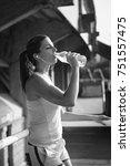 sporty woman taking a break for ... | Shutterstock . vector #751557475