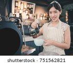 young asian woman barista... | Shutterstock . vector #751562821