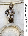 Small photo of Brussels, Belgium - April 2015: Manneken Pis (Little Man Pee), a landmark small bronze sculpture, located near Grand Place in the city of Brussels, Belgium