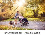 Stock photo senior man and elderly woman in wheelchair in autumn nature man with his mother on a walk with a 751581355