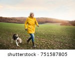 active senior woman with dog on ... | Shutterstock . vector #751587805