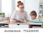 female private tutor helping... | Shutterstock . vector #751634245
