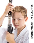 Pre-teen boy with a samurai sword isolated on a white background - stock photo
