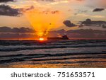 sunset over sea ship silhouette ... | Shutterstock . vector #751653571