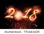 happy new year   red fireworks... | Shutterstock . vector #751661635