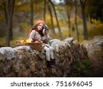 ittle girl with big dog in the... | Shutterstock . vector #751696045