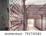 rusted steel pole on chain link ... | Shutterstock . vector #751710181