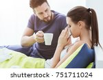 young woman in bed with cold... | Shutterstock . vector #751711024