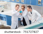team of chemists in lab coats... | Shutterstock . vector #751727827