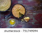 Stock photo top view of cast iron pans of cornbread in rustic setting 751749094