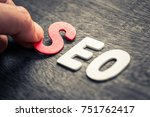 hand place wood letters for seo ... | Shutterstock . vector #751762417