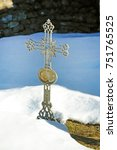 old cross in the snow in a... | Shutterstock . vector #751765525