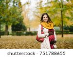 happy pregnant woman with scarf ... | Shutterstock . vector #751788655