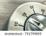 Small photo of 15 Minutes - Quarter Hour - Macro Of An Analog Chrome Kitchen Timer On Wooden Table