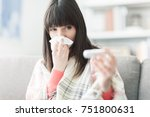 young sick woman with cold and... | Shutterstock . vector #751800631