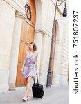woman with trolly walking along ... | Shutterstock . vector #751807237