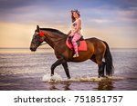 Young Woman Riding Horse In Se...