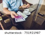 man hands money to another man. ... | Shutterstock . vector #751921987