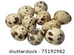 Quail eggs isolated on white with depth of field blur - stock photo