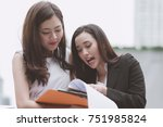 two beautiful confident asian... | Shutterstock . vector #751985824