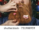 a bearded man with a decorated... | Shutterstock . vector #751988959