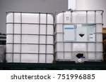 Small photo of Large acid-proof plastic containers for transportation of corrosive and acidic chemicals.