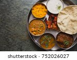 Small photo of Typical curry set meal of meals south India with Chicken Tandoori, Mutton Curry, Subji (Vegetarian Curry),Papadum,Nan,Raita (Yogurt with cucumber),Mutter Paneer ,and Pulao Rice
