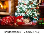 child sleeping at fire place on ... | Shutterstock . vector #752027719