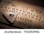 talking board and planchette... | Shutterstock . vector #752053981
