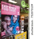 Small photo of Newbury, Northbrook Street, Berkshire, England - November 3, 2017: Oxfam emergency appeal poster in charity shop window, East Africa food crisis