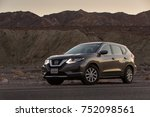 Small photo of Death Valley, California - November 2, 2017: View of a grey 2017 Nissan Rogue in the desert.