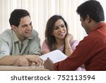 couple talking to insurance... | Shutterstock . vector #752113594