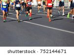 marathon runners running on... | Shutterstock . vector #752144671