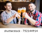 two handsome men is celebrating ... | Shutterstock . vector #752144914