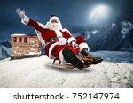 crazy santa claus on a sledge.... | Shutterstock . vector #752147974