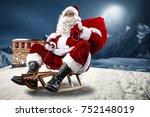 crazy santa claus on a sledge.... | Shutterstock . vector #752148019