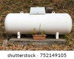 a propane gas tank  in a garden. | Shutterstock . vector #752149105
