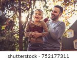 father have play with daughter... | Shutterstock . vector #752177311