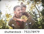 happy father and daughter... | Shutterstock . vector #752178979