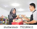 female customer paying her... | Shutterstock . vector #752180611