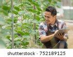 young asian male farmer... | Shutterstock . vector #752189125