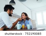 young couple enjoying eating... | Shutterstock . vector #752190085