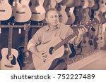 adult glad cheerful  guitarist... | Shutterstock . vector #752227489