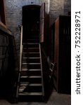 Small photo of Staircase and entrace of an abandoned and old attic