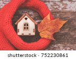 toy house is wrapped in a warm ... | Shutterstock . vector #752230861