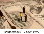 a shady business deal depicted... | Shutterstock . vector #752241997