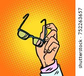 glasses in hand  vision and... | Shutterstock .eps vector #752263657