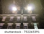 Snow Falling At Night In Front...