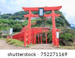 Stock photo a long winding tunnel of sacred red shinto torii gates on a mountain forms the entrance to the 752271169