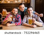 three young men in casual... | Shutterstock . vector #752296465